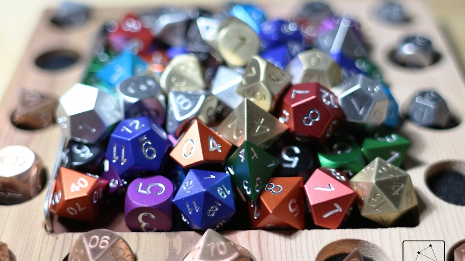 Minimalist metal dice made from Aluminum, Steel, Copper, Brass, Bronze, Titanium, Magnesium and Tungsten. Machined and engraved.