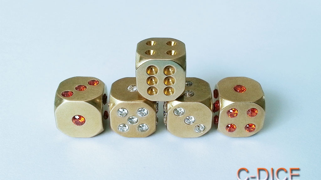 Project image for C-DICE: Solid brass dice with natural zircon crystal pips