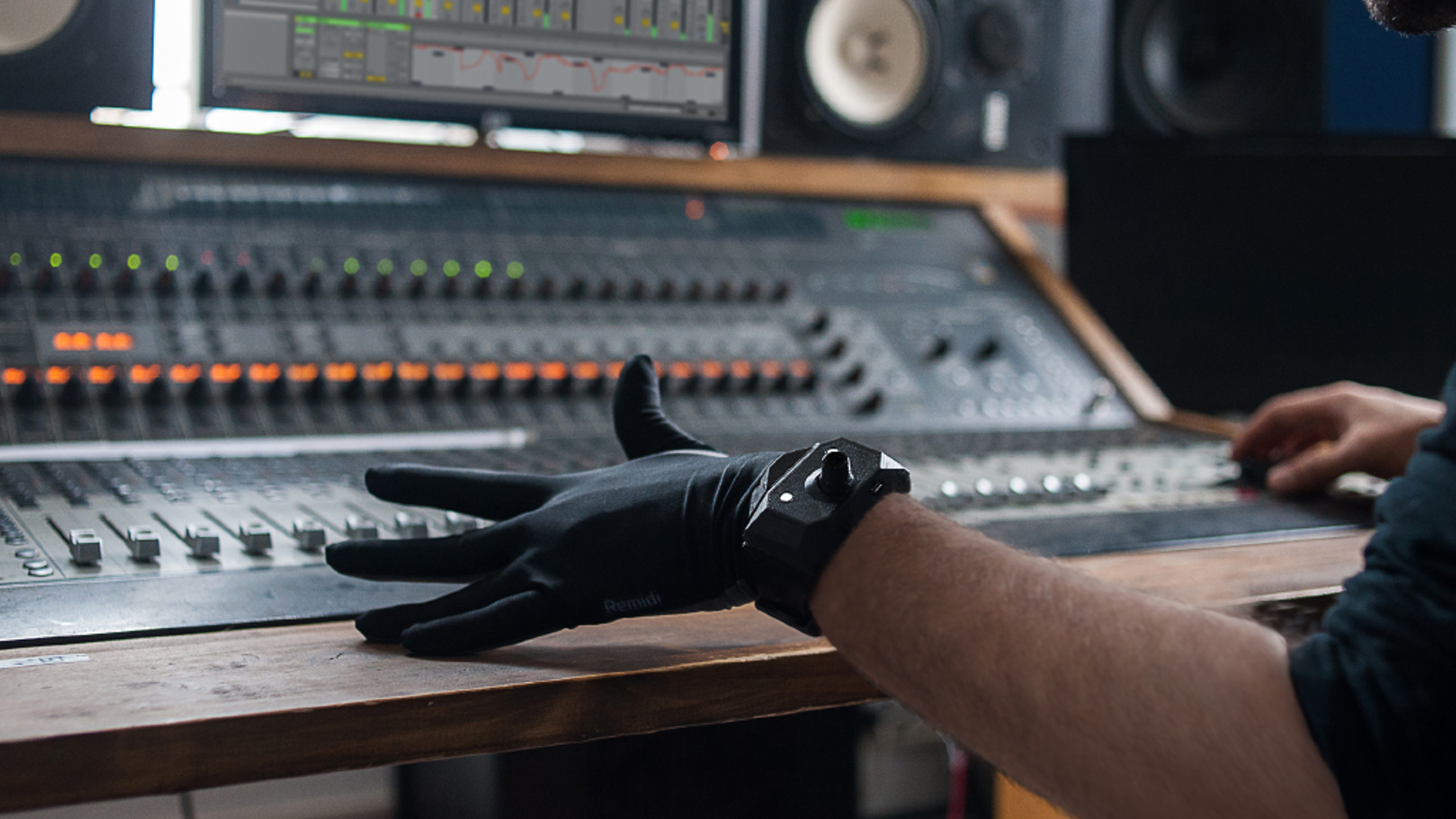 Sensors in fingers & palm trigger custom sounds while connected wrist-controller/hand gestures control effects with reverb, echo, etc.