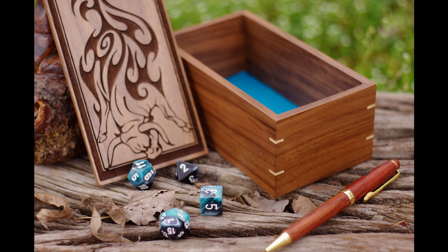 Elegant wooden boxes with unique custom artwork for dice and gaming accessories. Designed with RPG players and collectors in mind.