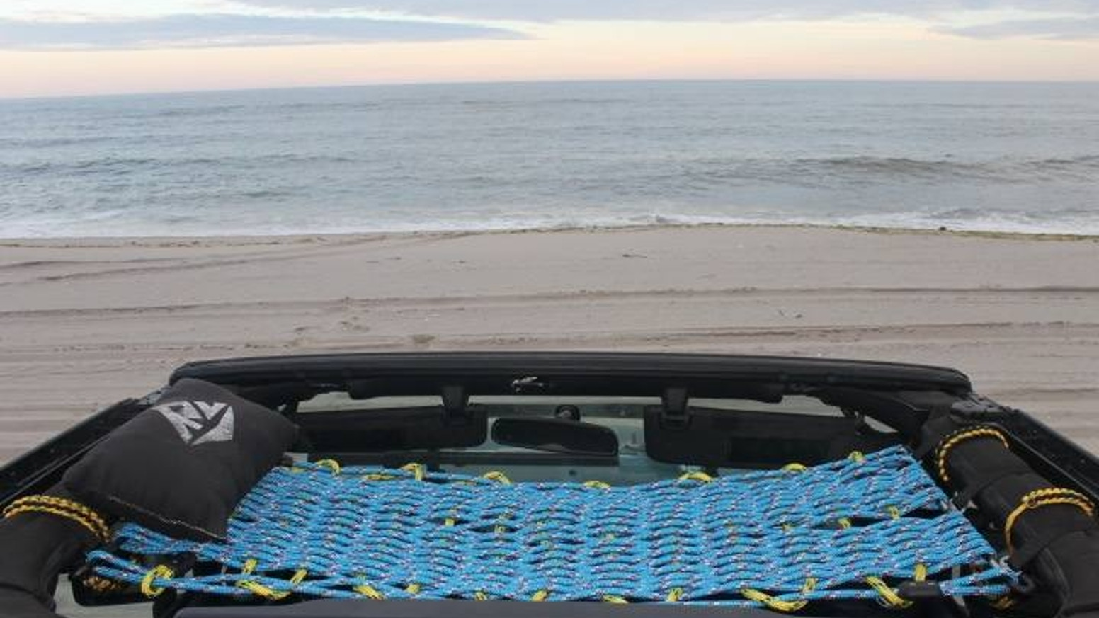 A hand-woven, UV resistant, Polyester rope cot that has a unique easy-on/easy-off design which attaches to your Jeep Wrangler!