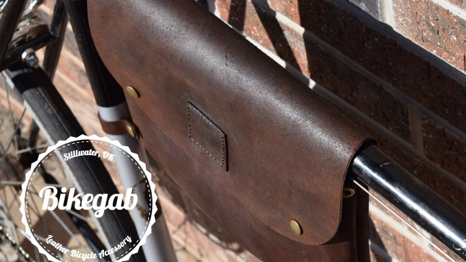 Hand made affordable leather bicycle frame bag that gives your bike a nice fashionable touch and can be used as a crossbody bag!