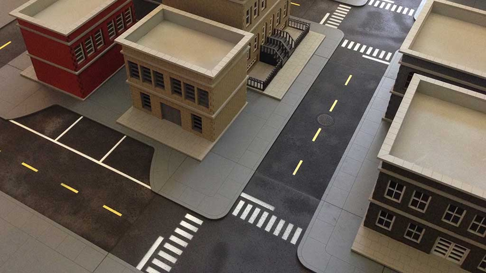 A modular system for creating a city street layout on your gaming table.  With just spray paint and a few hours, you'll be ready to go!