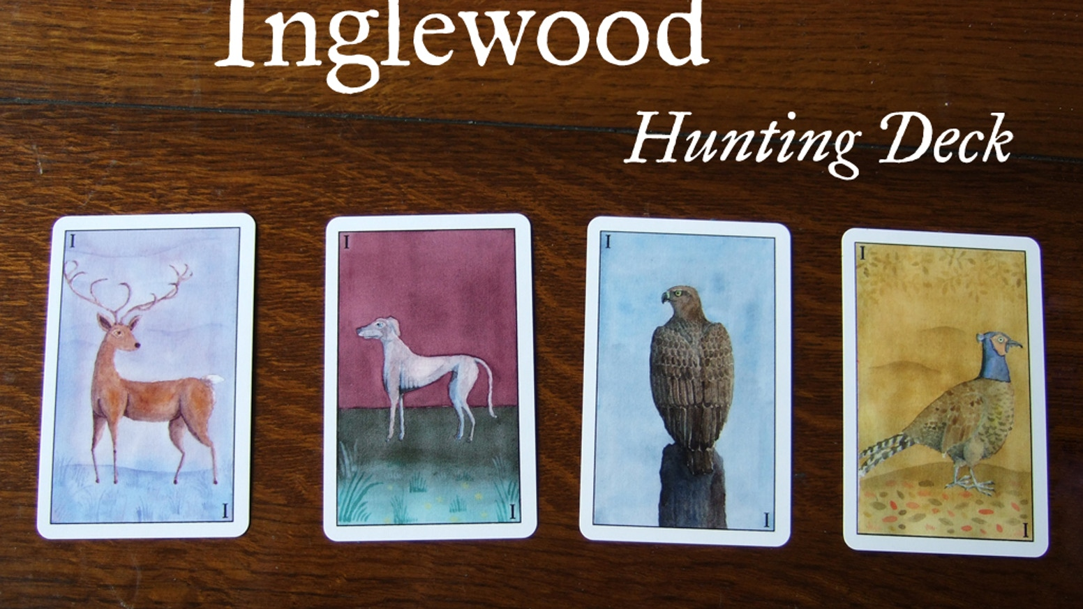 """A unique deck of playing cards featuring watercolour artwork, inspired by 15th century """"hunting-suited"""" hand-painted playing cards."""