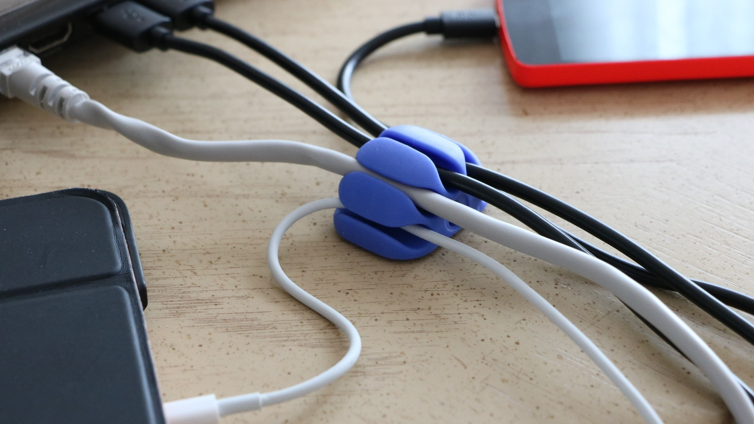 This patent pending cable organizer can hold up to 5 cables at the same  time and