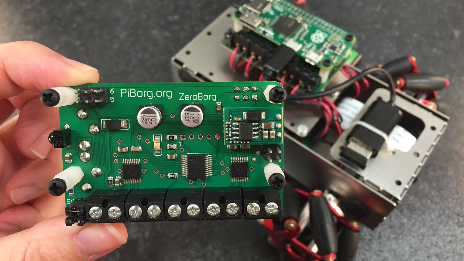 ZeroBorg; a brand new small but powerful motor controller and sensor board for the Raspberry Pi Zero. Build tiny but awesome robots!