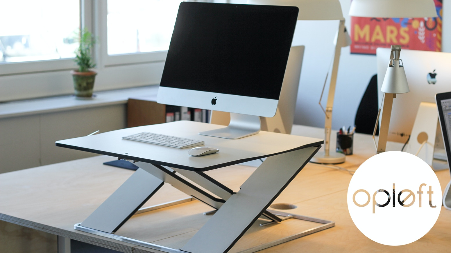 OPLFT - A slim work surface that transforms any table into a  height-adjustable sit