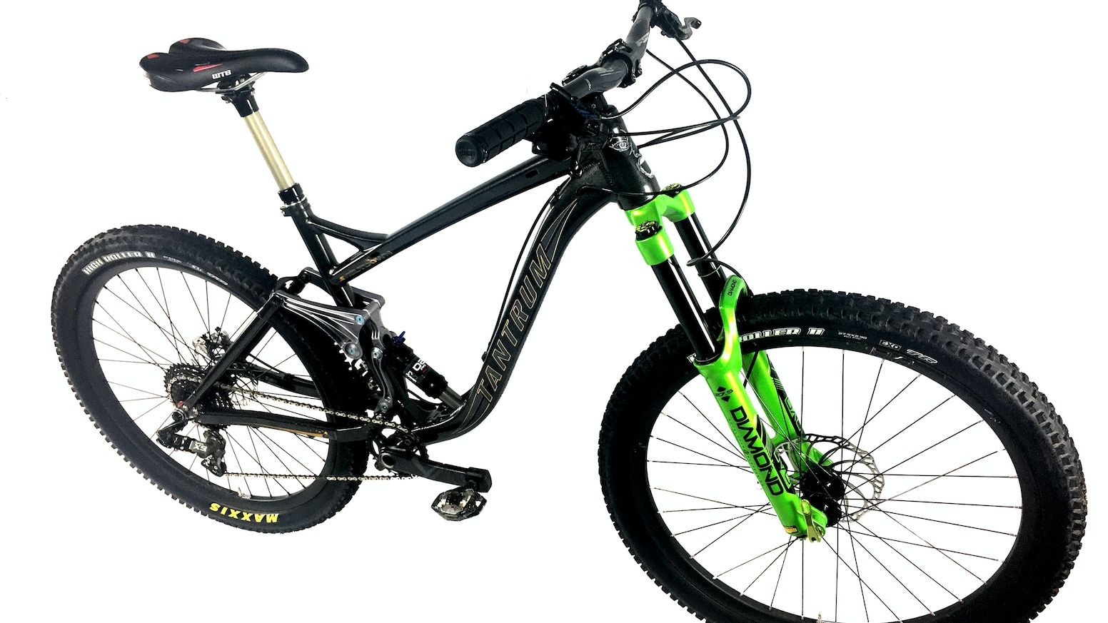 """The Missing Link """"does the impossible; pedals like a hardtail and delivers a plush ride over bumps - without levers or electronics"""""""