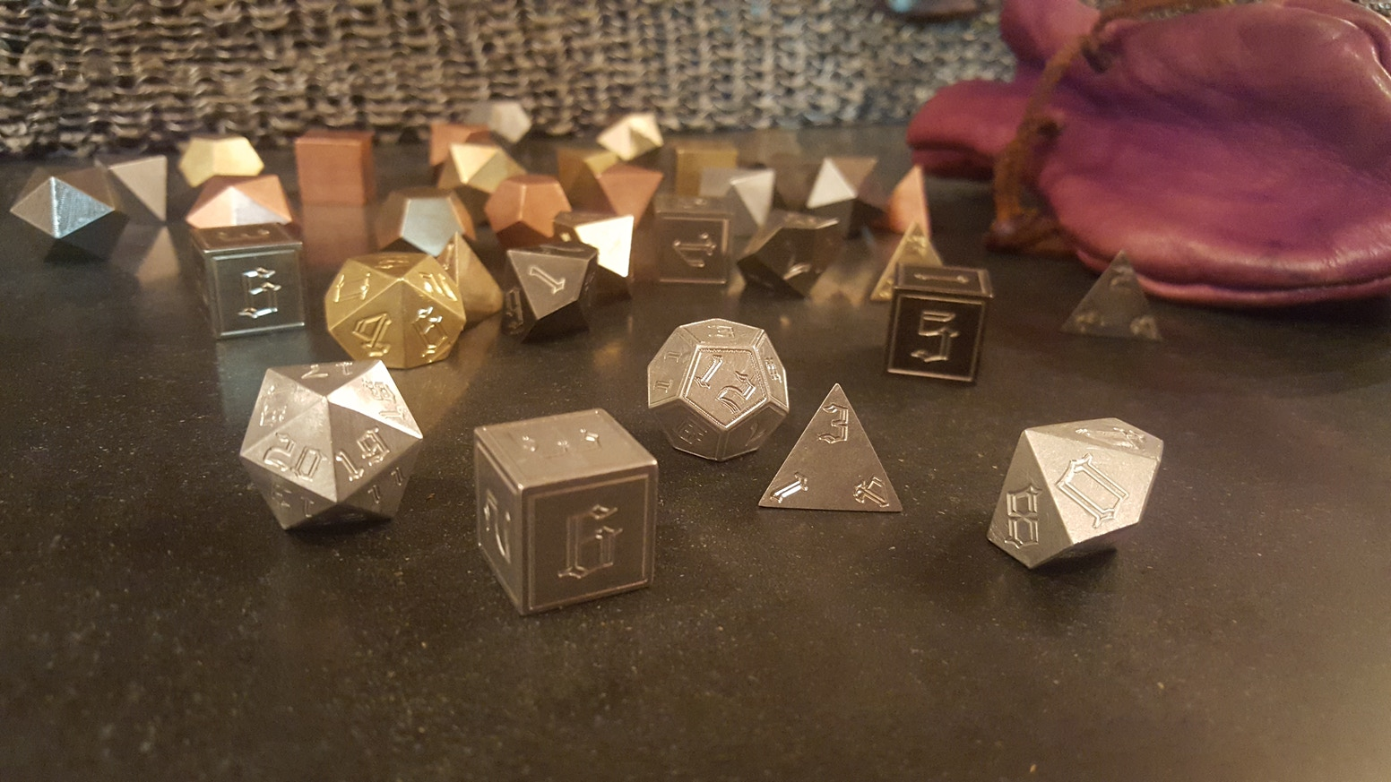 A line of cool precision metal gaming dice that will be the envy of gamer and non-gamer alike.