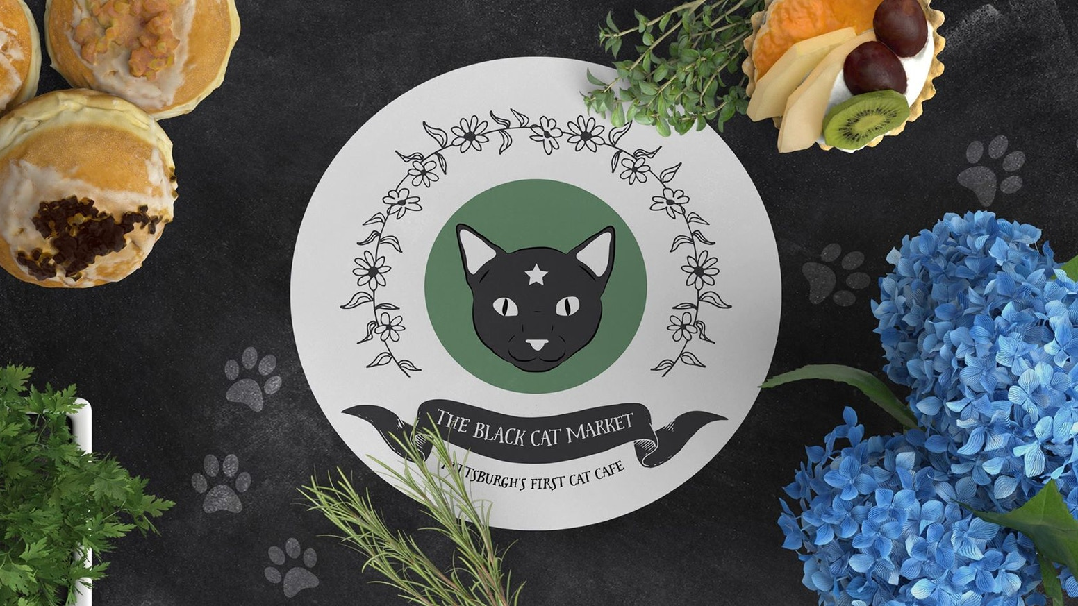 The Black Cat Market will be Pittsburgh's first cat cafe; where people can enjoy coffee while hanging out with adoptable cats!