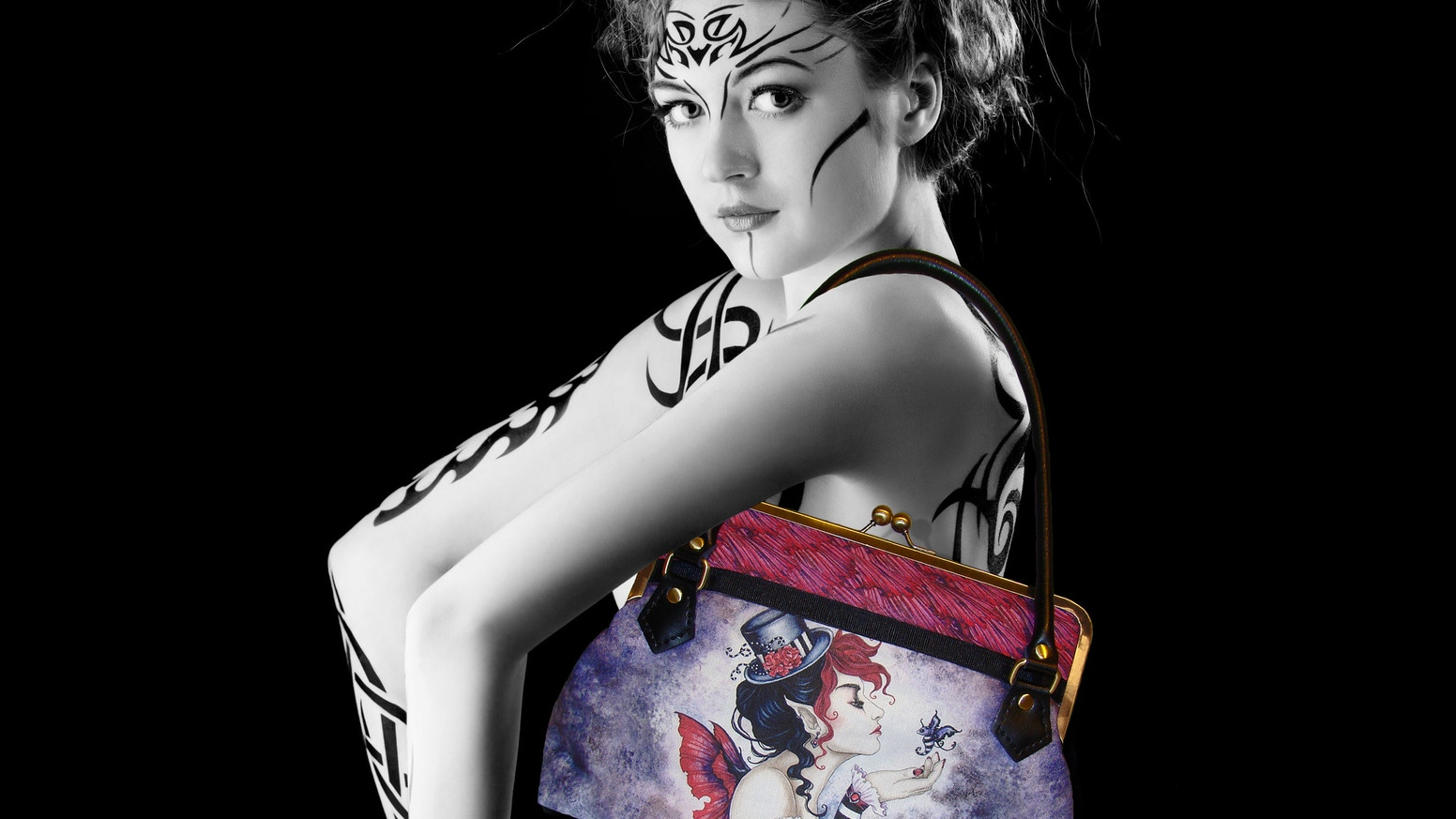 My newest handbag design. Handmade with exclusive fabric featuring licensed artwork by several great artists & my custom fob.