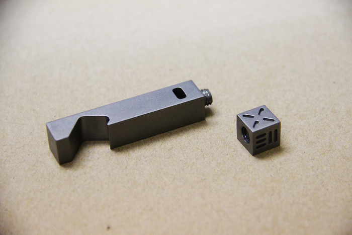 A Minimalist 100% Titanium opener with a detachable dice. Open your bottle, enjoy the fun and games!