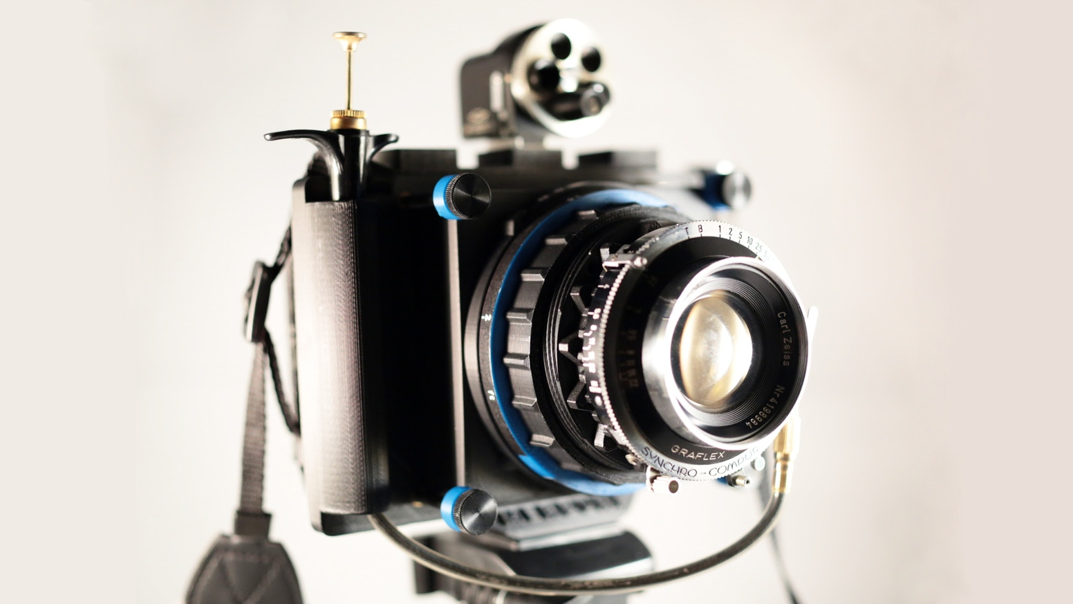 A modular, open camera system capable of shooting any format (medium and large format film, digital, Instax...) and using any lens.