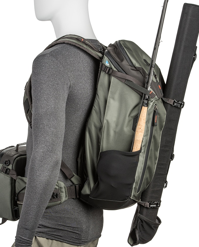 Two rigged fly rods, multiple un-rigged fly rods or wading staff carries easily on the front and/or side panel