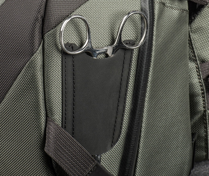 Quick access hemostat tool holder on side of beltpack