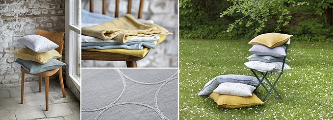 Throw cushions in muted greys & blues and heart-warming ochre