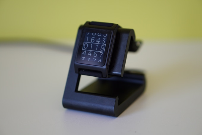 Pebble 2 charging on a Black TimeDock