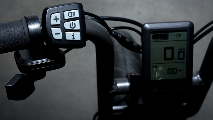 A Thumb Throttle controls the motor and an LCD screen displays key information like speed and distance