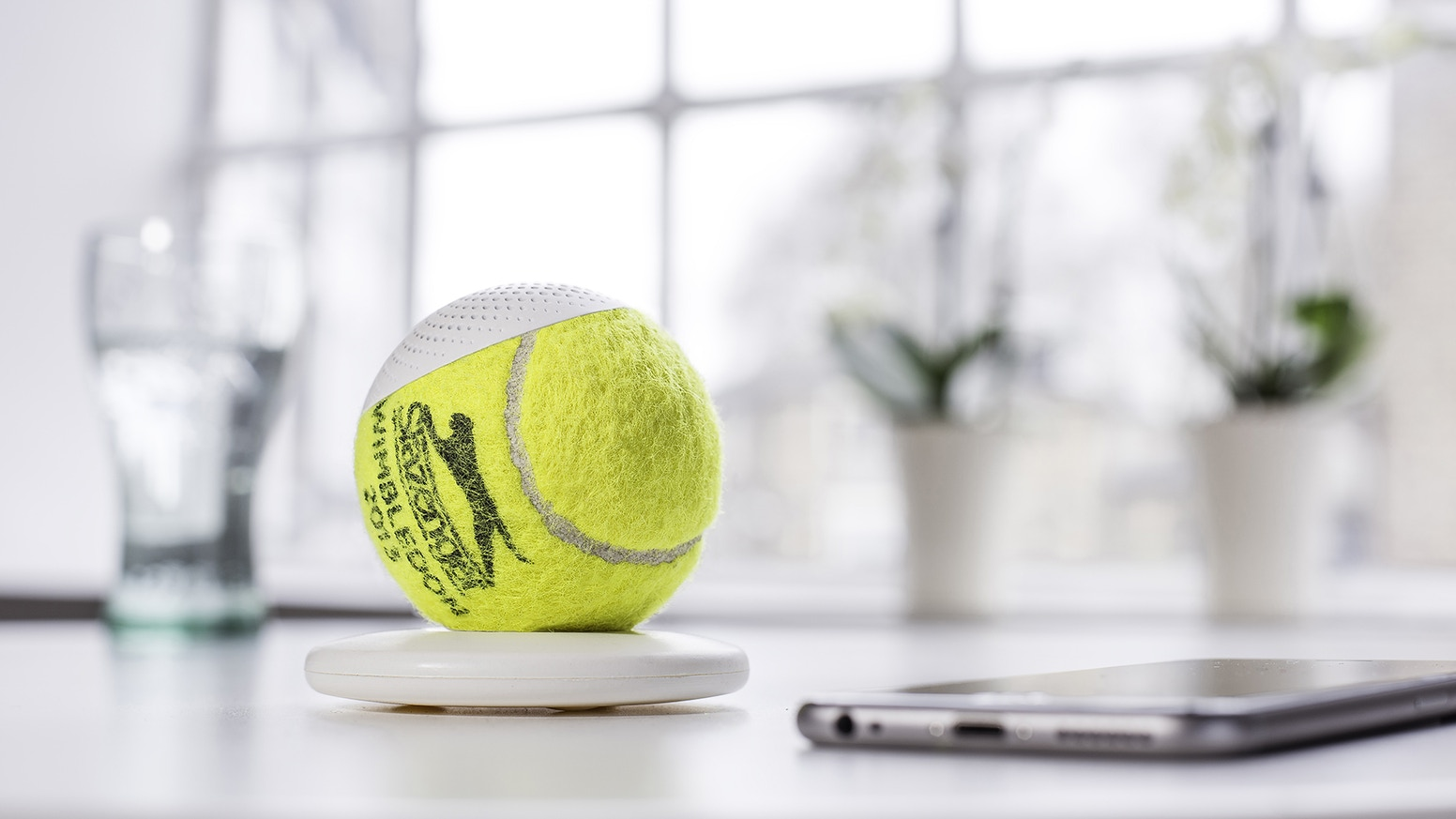 An icon of reuse and piece of tennis history fuse into a tactile Bluetooth speaker with a warm and rich sound.