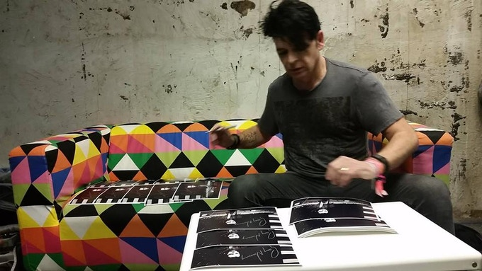 Gary Numan signing photos for Electronic Voyager at Moogfest 2016