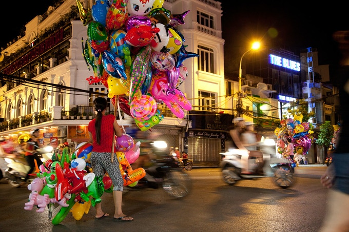 Balloon Seller In Hanoi Rush Hour, Vietnam (Cate Gunn)