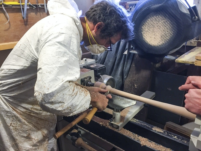 Grinding away on a hand-turned bat