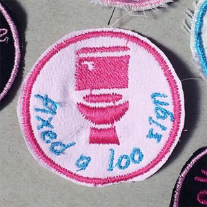 "[merit badge: ""fixed a loo sign""]"