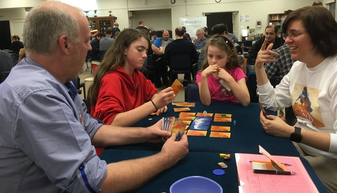 Julia enjoys a game of Hoard with the Shaw family at Board Games by the Bay Auckland, May 21, 2016