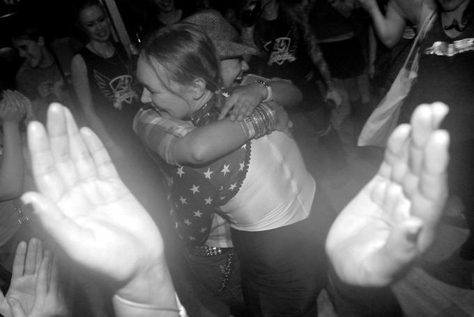 Belle Star hug a skater from London at the bout after party.