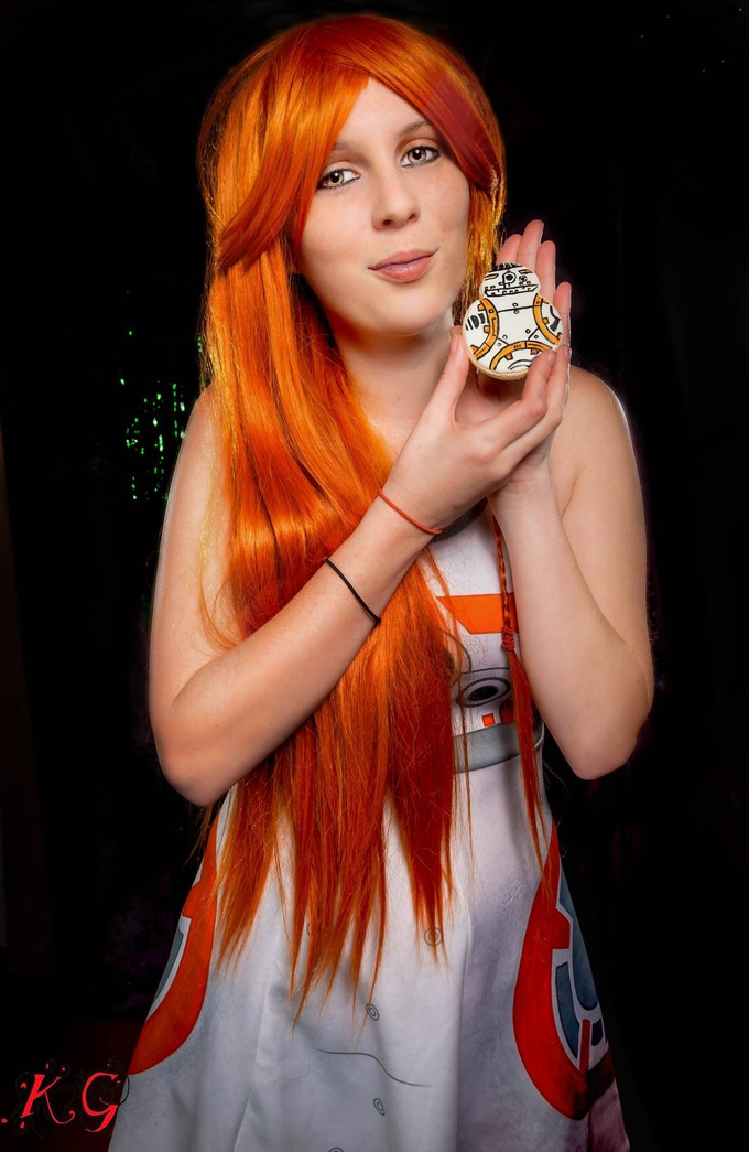 Cosplayer Toni X Temptress as BB-8 holding one of our BB - ATE cookies.