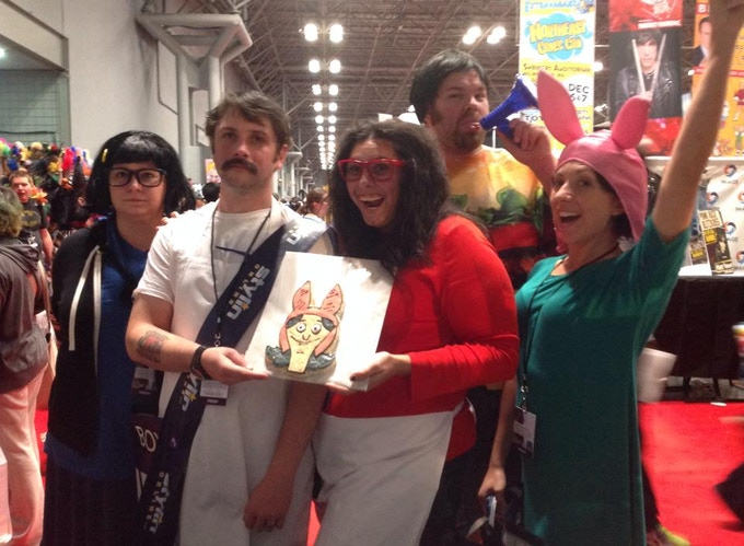 A cosplay Belcher family from Bob's Burgers shows off our Louise cookie!