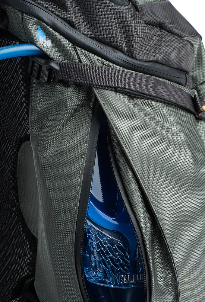 Dedicated zippered hydration compartment on side fits most 2L reservoirs or 32oz water bottles