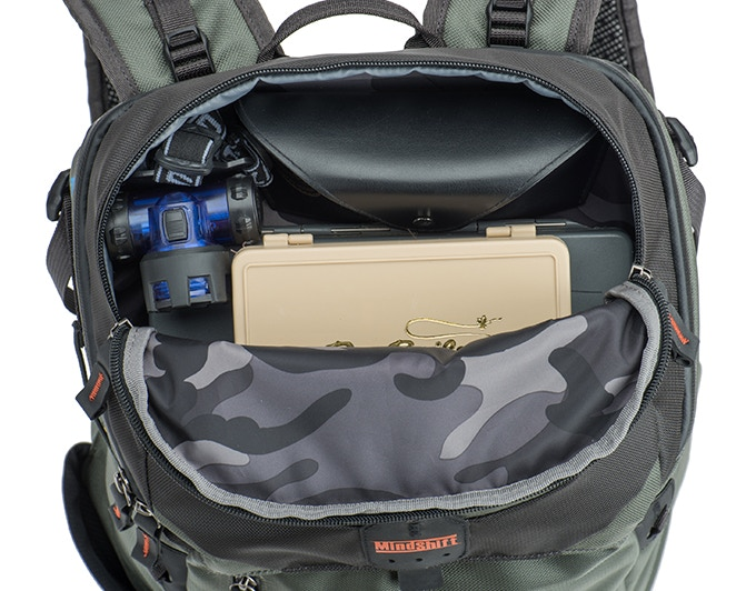 Top zippered pocket for quick access items