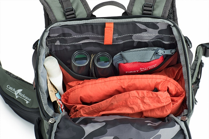 Backpack holds jacket/layers, summer style waders, hat, gloves, lunch, sunscreen, binoculars, walkie-talkie, maps, etc.