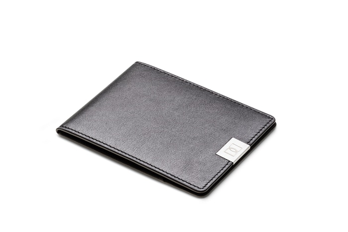 "Ultra thin functional leather wallet: just 0.2"" thick! Clever design that makes the DUN wallet able to carry cards, cash and coins."