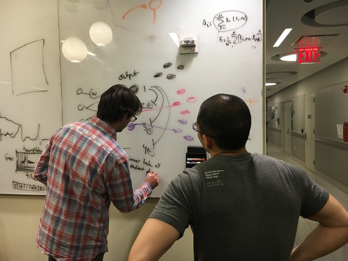Brian and Sam in a whiteboarding session at the Buzsáki lab at NYU