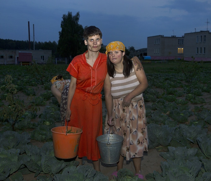 Free Labor - Disabled women working in a field. Institutions are partly self-sufficient. Patients are forced to work in fields, clean and cook.