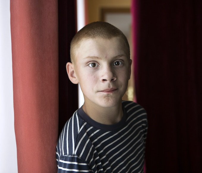 Lyosha. This severely autistic boy is very active and inpatient, however in front of a camera he would calm down immediately. He loved the flash light and would pose perfectly still until the light would fire.