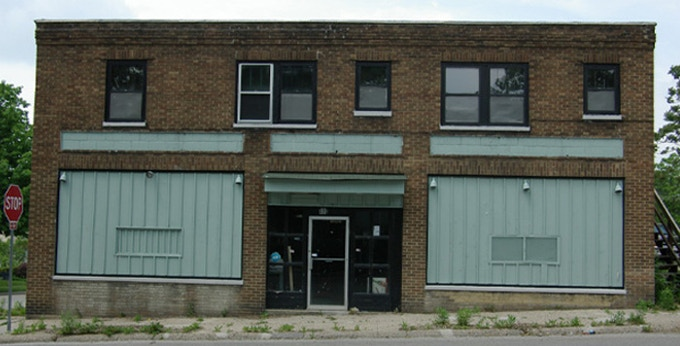 The building had severely outdated electrical and plumbing systems and absence of gutters had allowed water for years to seep through the foundation into the basement - It was a rundown, neglected, leaky old building held together with mediocre repairs.