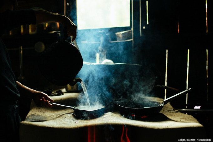 Boiling water for tea in a small shop on trekking route.