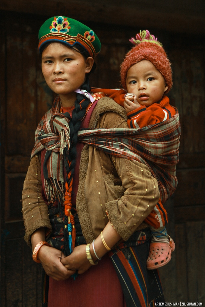 Mother with child in traditional Tamang dress.