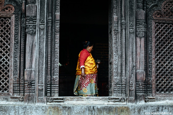Woman inside the temple on Durbar square in Bhaktapur.