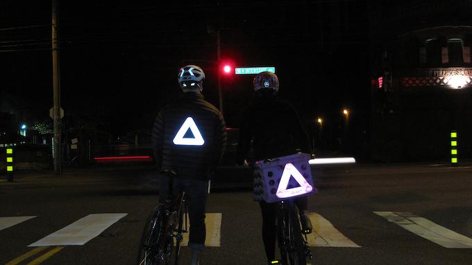 Silver and pink reflectors at night