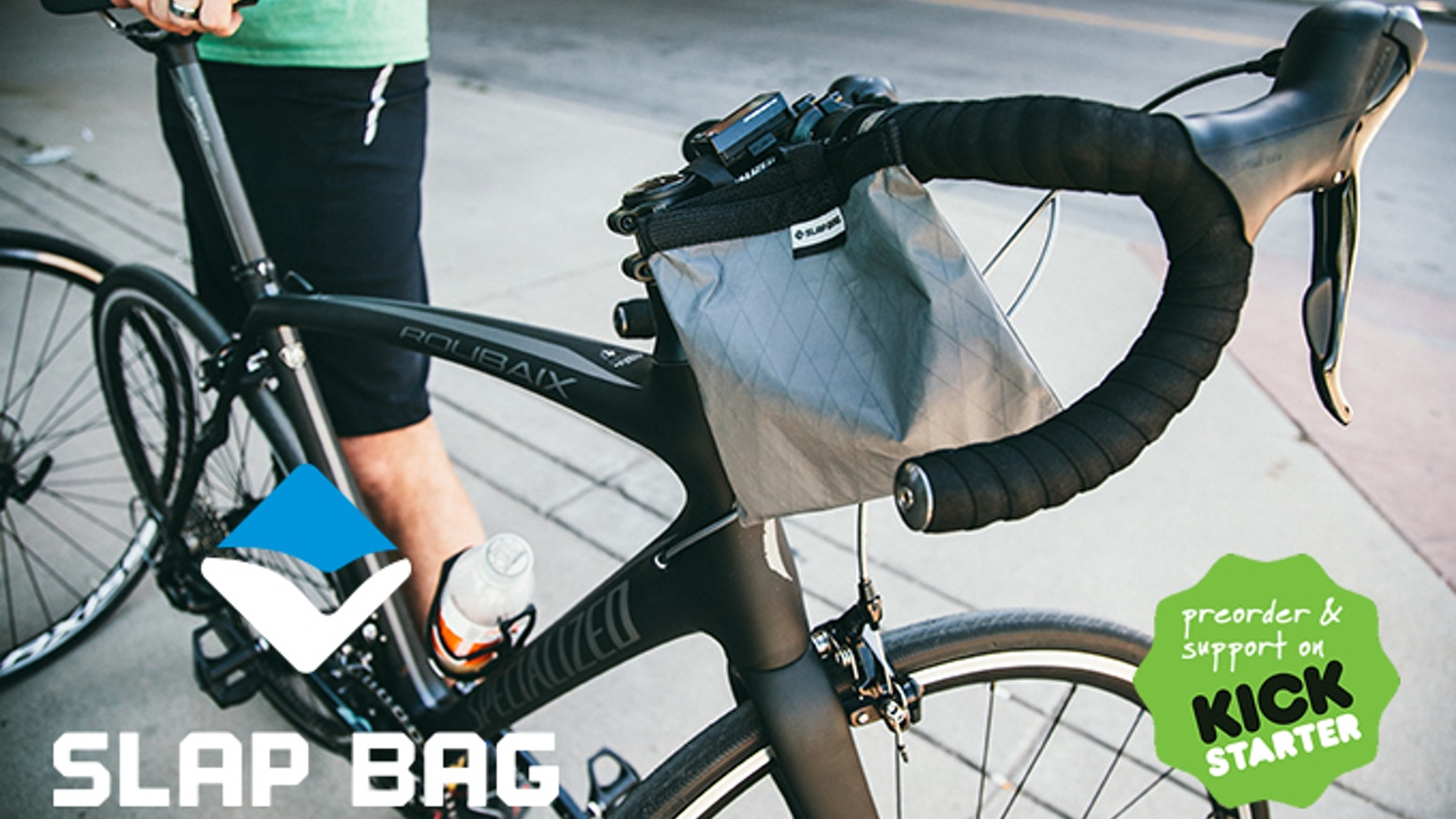A bike handlebar mounted pouch that opens and closes with just one hand. The glove compartment your bike always wanted!