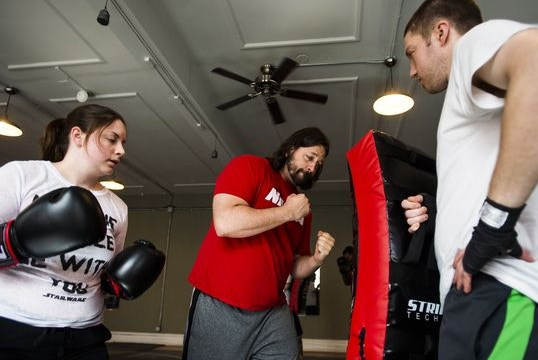 Joe Dressel teaches technique to students Olivia Sears, left, and William Sweeney, right, on April 12, 2016 at Hanover Boxing Club on Carlisle Street in downtown Hanover.  (Photo: Shane Dunlap, The Evening Sun)