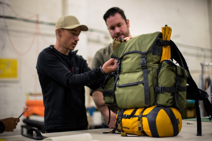 Joe and Tony making revisions to a prototype scout backpack