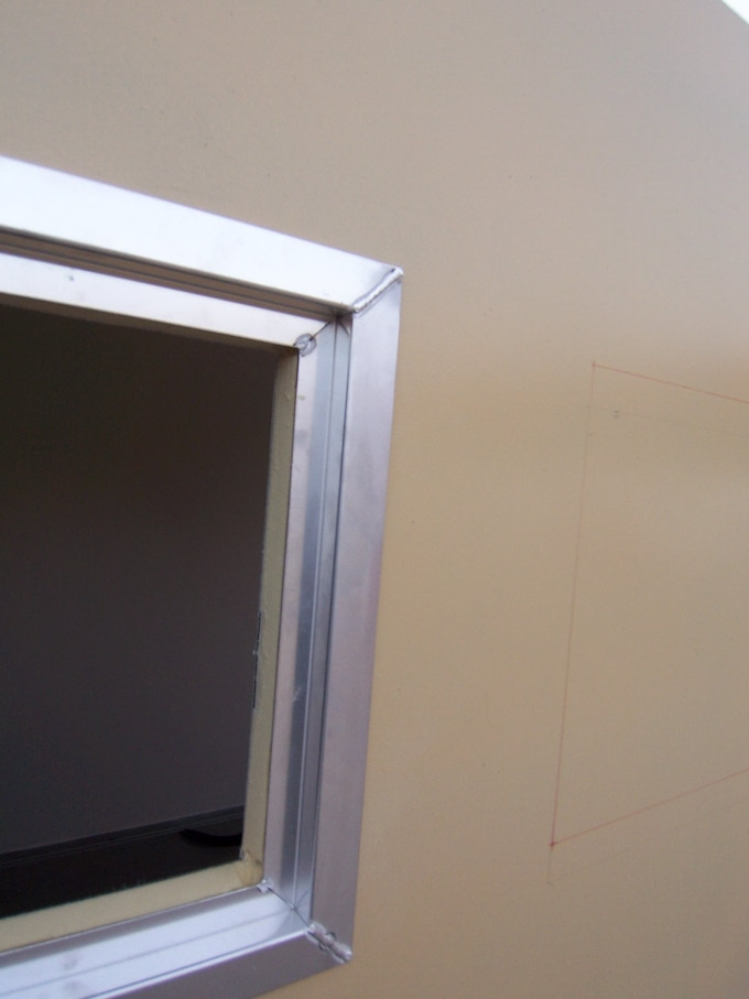 Carefully remove the outer section of the wall to leave a profiled cutout tailored to house the Z-profile frame.