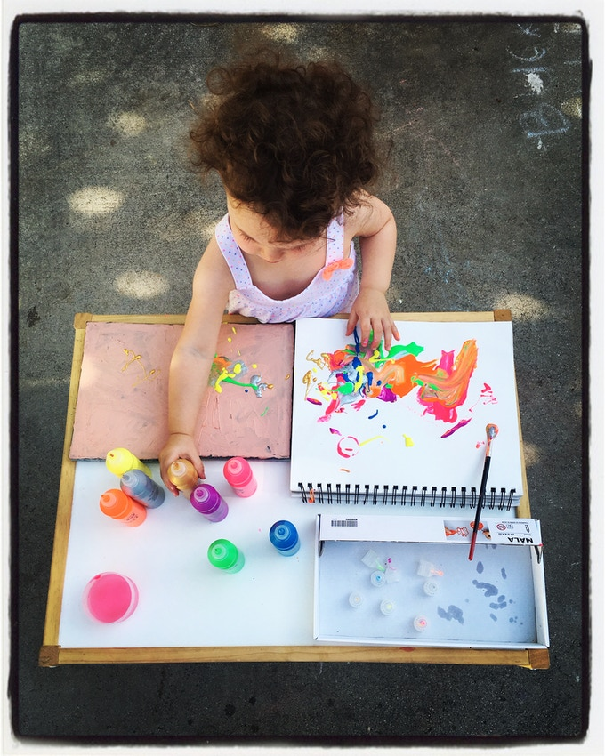 The trick is getting her to paint on paper...