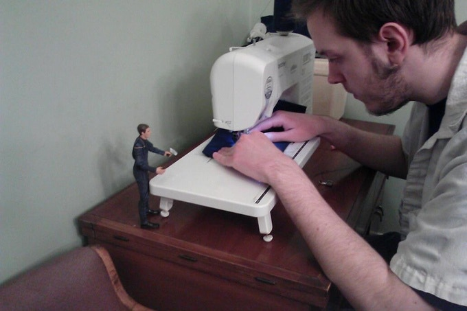 Horizon creator Tommy Kraft hand-sewing uniforms.