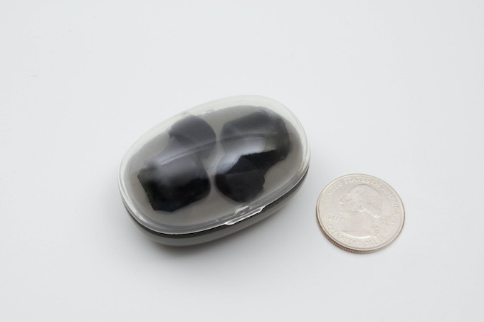 The Charging Pod next to a US quarter